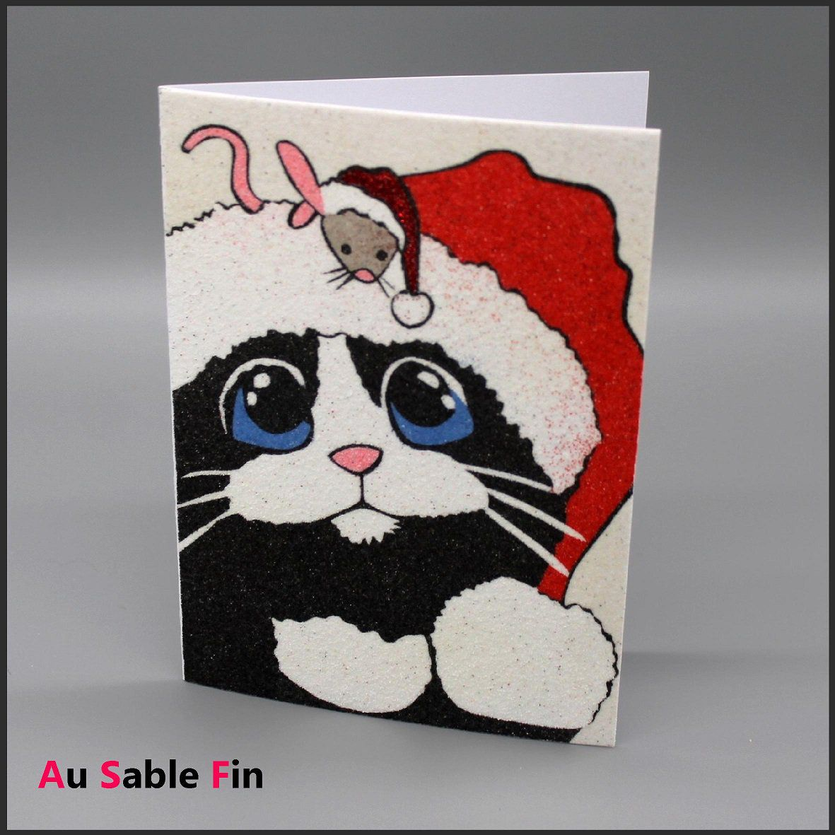Carte en sable - Chat de Noël